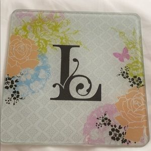 """Trivet with initial """"L"""""""